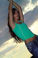 Beautifull woman listening to music through headphones outdoors as she dances