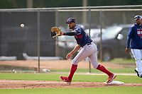 FCL Red Sox first baseman Danny Diaz (17) stretches for a throw during a game against the FCL Twins on July 3, 2021 at CenturyLink Sports Complex in Fort Myers, Florida.  (Mike Janes/Four Seam Images)