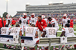 Rutgers Scarlet Knights defensive back Davon Jacobs (29) and other defensive players get a pep talk during the game between the Rutgers Scarlet Knights and the SMU Mustangs at the Gerald J. Ford Stadium in Fort Worth, Texas. Rutgers defeats SMU 55 to 52 in triple OT.