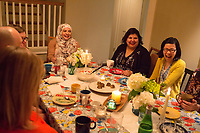 """SEATTLE, WA-APRIL 17, 2017: Amanda Saab, center, Anjana Agarwal,  and Charissa Pomrehn (yellow sweater, right) had a lot to laugh about during the dinner party.<br /> <br /> Amanda Saab, along with her husband Hussein Saab, co-hosted a """"dinner with your Muslim neighbor"""" at the home of Stefanie and Nason (cq) Fox in Seattle, WA on a return trip April 17th 2017. The couple now live in Detroit. (Photo by Meryl Schenker/For The Washington Post)"""