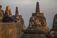Borobudur, Java, Indonesia.  Woman Praying to the Sunrise.