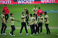 The Black Caps celebrate Kane Williamson's catch of Marcus Stoinis during the 4th international men's T20 cricket match between the New Zealand Black Caps and Australia at Sky Stadium in Wellington, New Zealand on Friday, 5 March 2021. Photo: Dave Lintott / lintottphoto.co.nz