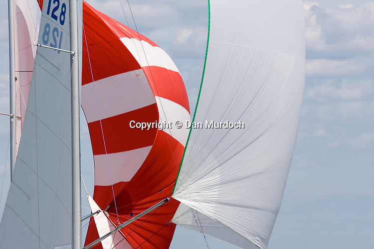 Sailboat spinnakers side by side