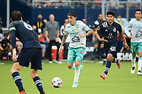 KANSAS CITY, KS - AUGUST 10: Omar Fernandez #25 Club Leon with the ball during a game between Club Leon and Sporting Kansas City at Children's Mercy Park on August 10, 2021 in Kansas City, Kansas.