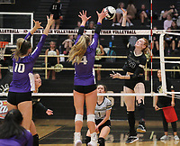 Sophie Snodgrass (10) and Kennedy Phelan (2) of Fayetteville try to block spike of Maddie Lee (23) of Bentonville on Thursday, Oct.  7, 2021, during play at Tiger Arena in Bentonville. Visit nwaonline.com/211008Daily/ for today's photo gallery.<br /> (Special to the NWA Democrat-Gazette/David Beach)