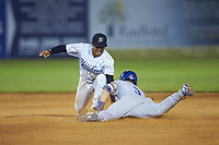 Jake Means (9) of the Burlington Royals slides into second base ahead of the tag by Luis Santos (13) of the Pulaski Yankees at Calfee Park on August 31, 2019 in Pulaski, Virginia. The Yankees defeated the Royals 6-0. (Brian Westerholt/Four Seam Images)