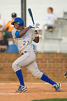 Luis Del Rosario #27 of the Burlington Royals follows through on his swing versus the Johnson City Cardinals at Howard Johnson Stadium June 27, 2009 in Johnson City, Tennessee. (Photo by Brian Westerholt / Four Seam Images)