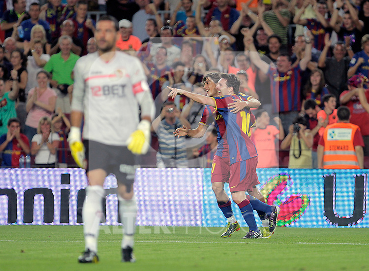 FC Barcelona's Lionel Messi (r) and Bojan Krkic celebrate goal in presence of Sevilla's Andres Palop during SuperCup of Spain Final match. August 21,2010. (ALTERPHOTOS/Acero)