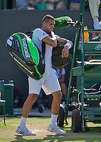 England, London, Juli 04, 2015, Tennis, Wimbledon,  Jo-Wilfried Tsonga (FRA) makes his way out after losing his match against  Ivo Karlovic (CRO) <br /> Photo: Tennisimages/Henk Koster
