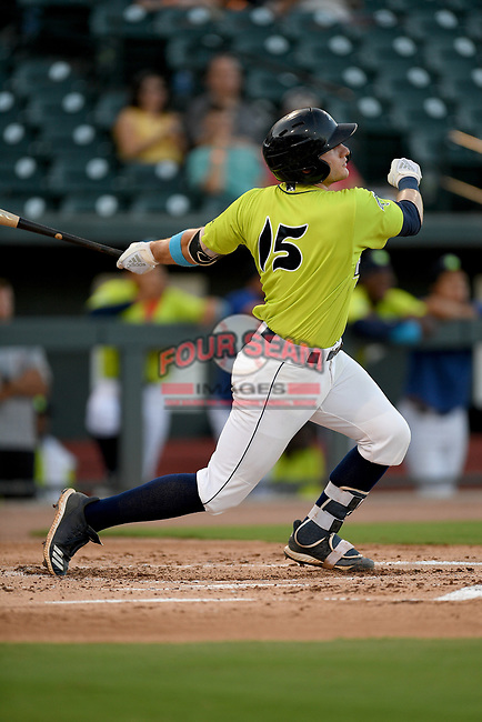 Catcher Hayden Senger (15) of the Columbia Fireflies bats in a game against the Hickory Crawdads on Wednesday, August 28, 2019, at Segra Park in Columbia, South Carolina. Hickory won, 7-0. (Tom Priddy/Four Seam Images)