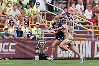 NEWTON, MA - MAY 22: Andie Aldave #13 of Notre Dame brings the ball forward as Hollie Schleicher #28 of Boston College defends during NCAA Division I Women's Lacrosse Tournament quarterfinal round game between Notre Dame and Boston College at Newton Campus Lacrosse Field on May 22, 2021 in Newton, Massachusetts.