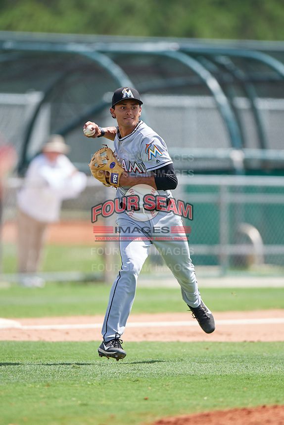 GCL Marlins third baseman Elliott Barzilli (12) throws to first base during the first game of a doubleheader against the GCL Nationals on July 23, 2017 at Roger Dean Stadium Complex in Jupiter, Florida.  GCL Nationals defeated the GCL Marlins 4-0.  (Mike Janes/Four Seam Images)