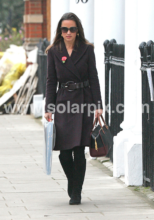 **ALL ROUND PICTURES FROM SOLARPIX.COM**                                             **WORLDWIDE SYNDICATION RIGHTS**                                                                                  Pippa Middleton returning from the shops this morning in South Kensington, London.                                                                       This pic:    Pippa Middleton                                                                                          JOB REF:     14173   WMB       DATE:   10.11.11                                                         **MUST CREDIT SOLARPIX.COM OR DOUBLE FEE WILL BE CHARGED**                                                                      **MUST AGREE FEE BEFORE ONLINE USAGE**                               **CALL US ON: +34 952 811 768 or LOW RATE FROM UK 0844 617 7637**