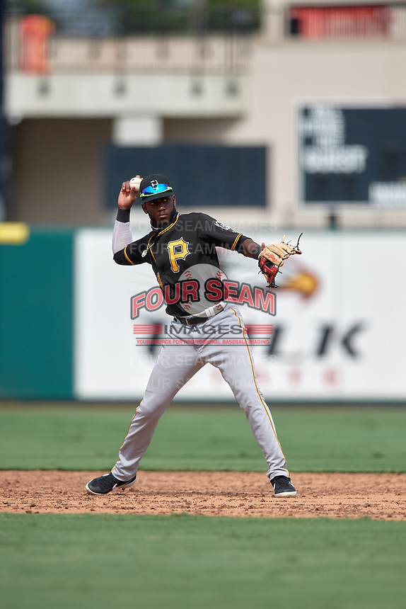 Pittsburgh Pirates Juan Jerez (24) throws to first base during a Florida Instructional League game against the Detroit Tigers on October 16, 2020 at Joker Marchant Stadium in Lakeland, Florida.  (Mike Janes/Four Seam Images)