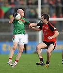 Michael Hogan of Kilmurry Ibrickane in action against Brian Murphy of Clondegad during their senior county final at Cusack park. Photograph by John Kelly.