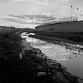 Juarez, Mexico<br /> May 19, 2008<br /> <br /> Life along the US/ Mexican - El Paso/Juarez border from the Mexican side. A trickle of water remains in the Rio Bravo - Rio Gande as the US diverts 75% for irrigation and the Mexicans divert the other 25%. The river itself is the US/Mexican border line.