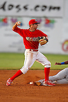 June 19, 2009:  Second Baseman Devin Goodwin of the Batavia Muckdogs throws to first as Welinton Ramirez slides in during a game at Dwyer Stadium in Batavia, NY.  The Muckdogs are the NY-Penn League Short-Season Class-A affiliate of the St. Louis Cardinals.  Photo by:  Mike Janes/Four Seam Images