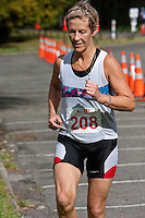 Physical Fitness.  Triathlon Runner, Blue Lake, Rotorua, New Zealand.