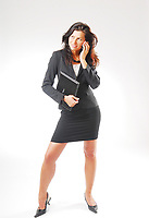 businesswoman / employee with files and mobile phone - 09.03.2009  Model-release-yes!