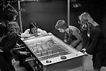 Timebridge Youth Club, Chells, Stevenage Hertfordshire. 1975.Children playing on a mini foot, football machine. 1970s UK