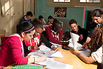 Education High School students in classroom interacting and working together