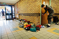 Pictured: A pile of football boots and other gear in containers in one of the stadium corridors. Thursday 18 January 2018<br /> Re: Players and staff of Newport County Football Club prepare at Newport Stadium, for their FA Cup game against Tottenham Hotspur in Wales, UK