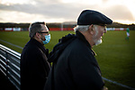 Redcar Athletic 1 Holker Old Boys 2, 31/10/2020. BM Bi-Folding Doors Football Park, Redcar, FA Vase First Round. A spectator in a face mask watching the first-half action as Redcar Athletic host Holker Old Boys in an FA Vase First Round tie at the BM Bi-Folding Doors Football Park, Redcar. The club was established in 1993 as Teesside Athletic but changed to Redcar Athletic in 2010 and were promoted into the Northern League Division Two in 2018. The visitors from the North West Counties League won this match by 2-1, watched by a crowd of 197 spectators. Photo by Colin McPherson.