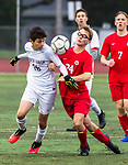CHESHIRE, CT-111220JS13—North Haven's Donovan Luna (26) and Cheshire's Austin Goldberg (34) battle for the ball during their SCC Division A semifinal game Thursday at Cheshire High School.<br /> Jim Shannon Republican-American
