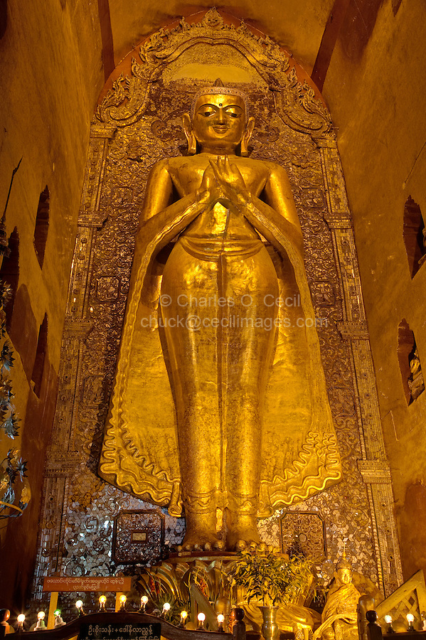 Myanmar, Burma. Bagan.  Buddha Statue, Ananda Temple, teak covered with gold leaf.  The Buddha is making the dhammachakka mudra, the hand gesture symbolizing the Buddha's first sermon.  This is the Buddha on the north side of the temple, dating back to when the temple was built between 1090 and 1105.