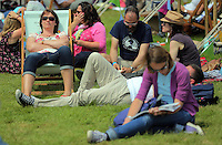 Pictured: People enjoy the sunshine on the festival green Monday 30 May 2016<br />Re: Hay Festival, Hay on Wye, Wales, UK