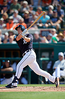 Detroit Tigers third baseman Brandon Dixon (12) hits a home run in the bottom of the third inning during a Grapefruit League Spring Training game against the Atlanta Braves on March 2, 2019 at Publix Field at Joker Marchant Stadium in Lakeland, Florida.  Tigers defeated the Braves 7-4.  (Mike Janes/Four Seam Images)