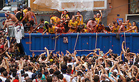 BUNYOL, SPAIN - AUGUST 31: People throug tomatoes from a lorry during the Tomatina August 31, 2005 in Bunyol, Valencia, Spain. Approximately 45,000 people pelted each other with a little over 100.000 kilograms of tomatoes. The tomatina is known as the world's largest tomato battle. Photo by Ander Gillenea
