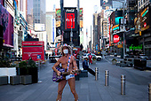 New York, New York<br /> March 18, 2020<br /> 11:11 AM<br /> <br /> Manhattan under coronavirus pandemic. <br /> <br /> The Naked Cowboy wearing a face mask in fear of catching or spreading the virus in Times Square that is void of tourists.