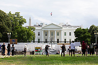 Demonstrators stand in Lafayette Square near the White House in Washington D.C., U.S., on Thursday, June 11, 2020.  Additional fencing that had been added around the White House due to protests over the death of George Floyd is slowly being removed.  Credit: Stefani Reynolds / CNP/AdMedia