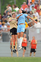 Becky Edwards (14) of FC Gold Pride and Jessica Landstrom (12) of Sky Blue FC goes up for a header. FC Gold Pride defeated Sky Blue FC 1-0 during a Women's Professional Soccer (WPS) match at Yurcak Field in Piscataway, NJ, on May 1, 2010.