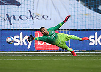 31st October 2020; The Kiyan Prince Foundation Stadium, London, England; English Football League Championship Football, Queen Park Rangers versus Cardiff City; Goalkeeper Seny Diengy of QPR out stretched and making the save