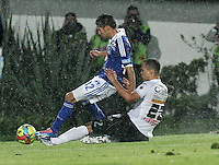 BOGOTA - COLOMBIA -07 -12-2013: Jonathan Agudelo (Izq.), jugador de Millonarios disputa el balón con Sebastian Puerta (Der.) jugador del Once Caldas en durante del partido por la fecha 6 de los cuadrangulares semifinales de la Liga Postobon II-2013, jugado en el estadio Nemesio Camacho El Campin de la ciudad de Bogota. / Jonathan Agudelo (L), player of Millonarios vies for the balla with Sebastian Puerta (R) player of Once Caldas during a match for the 6 date of the quadrangular semifinals of the Postobon Leaguje II-2013 at the Nemesio Camacho El Campin Stadium in Bogota city, Photo: VizzorImage  / Luis Ramirez / Staff.
