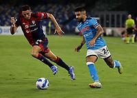 26th September 2021; Maradona Stadium, Naples, Italy; Serie A football, Napoli versus Cagliari :  Lorenzo Insigne of Napoli challenged by Giorgio Altare
