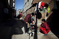 CHINA. Beijing. A family in Lao San Yu Village (a migrant worker village) in the southern district, Daxing. 2010