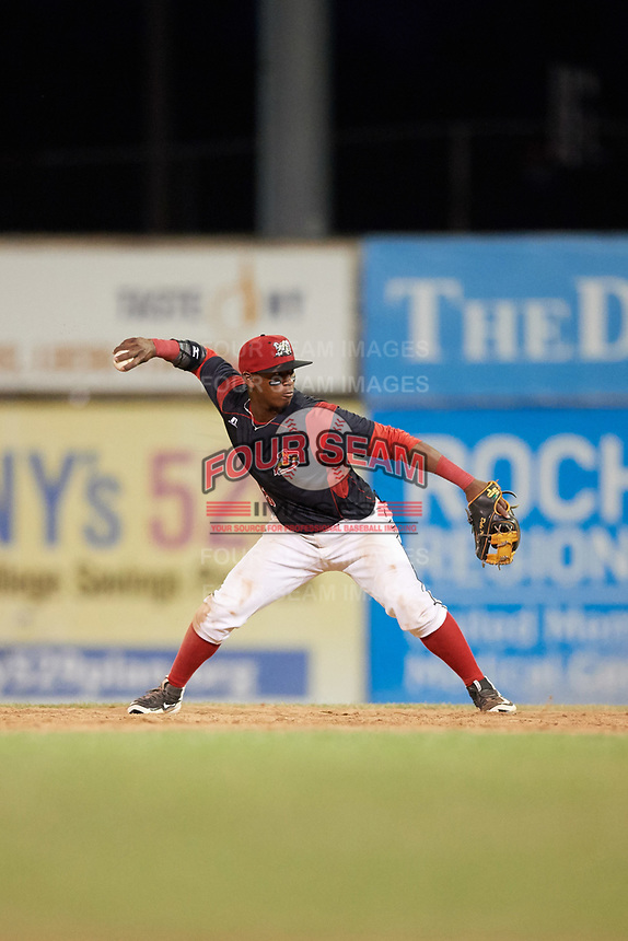 Batavia Muckdogs second baseman Samuel Castro (5) throws to first base during a game against the Auburn Doubledays on June 19, 2017 at Dwyer Stadium in Batavia, New York.  Batavia defeated Auburn 8-2 in both teams opening game of the season.  (Mike Janes/Four Seam Images)