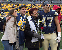 Pitt linebacker Matt Galambos (47) celebrates senior day with his family. The Pitt Panthers defeated the Syracuse Orange 76-61 at Heinz Field in Pittsburgh, Pennsylvania on November 26, 2016.