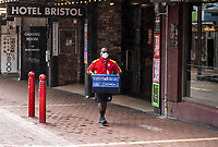 A NZ Post courier delivery worker carries deliveries down Cuba Mall during the COVID-19 pandemic lockdown in Wellington, New Zealand on Friday, 3 April 2020. Photo: Dave Lintott / lintottphoto.co.nz