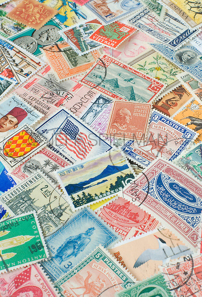 Assortment of Colorful Old Postage Stamps from Various Countries Around the World.<br /> <br /> AVAILABLE FOR COMMERCIAL OR EDITORIAL LICENSING FROM PLAINPICTURE.COM.  Please go to www.plainpicture.com and search for image # p569m791797.