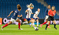 LE HAVRE, FRANCE - APRIL 13: Julie Ertz #8 of the USWNT passes the ball during a game between France and USWNT at Stade Oceane on April 13, 2021 in Le Havre, France.