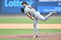 Hickory Crawdads starting pitcher Avery Weems (24) delivers a pitch during a game against the Asheville Tourists on July 26, 2021 at McCormick Field in Asheville, NC. (Tony Farlow/Four Seam Images)