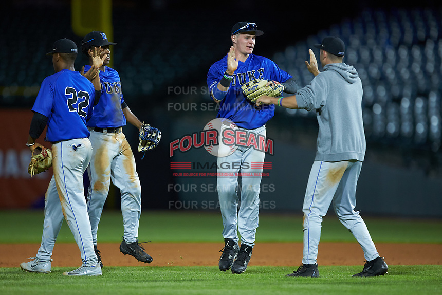 Griffin Conine (9) of the Duke Blue Devils celebrates with teammates following their win over the Clemson Tigers in Game Three of the 2017 ACC Baseball Championship at Louisville Slugger Field on May 23, 2017 in Louisville, Kentucky. The Blue Devils defeated the Tigers 6-3. (Brian Westerholt/Four Seam Images)