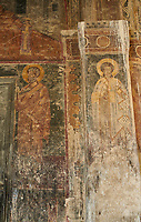 Pictures & images of the medieval fresco of saints on the front door of the Alaverdi St George Cathedral & monastery complex, 11th century, near Telavi, Georgia (country). <br /> <br /> At 50 meters high Alaverdi St George Cathedral was once the highest cathedral in Georgia (now its the nes Tblisi cathedral). The cathedral is part of a Georgian Orthodox monastery founded by the monk Joseph [Abba] Alaverdeli, who came from Antioch and settled in Alaverdi. On the UNESCO World Heritage Site Tentative List.