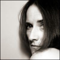 Self-portrait of photographer looking over her shoulder.