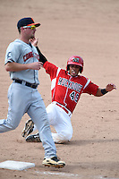 Batavia Muckdogs second baseman Iramis Olivencia (49) slides into third as third baseman Joey Pankake (46) covers the bag during the second game of a doubleheader against the Connecticut Tigers on July 20, 2014 at Dwyer Stadium in Batavia, New York.  Connecticut defeated Batavia 2-0.  (Mike Janes/Four Seam Images)
