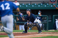 Lakeland Flying Tigers catcher Cooper Johnson (7) waits for a throw as PK Morris (12) attempts to score a run during a game against the Dunedin Blue Jays on June 8, 2021 at Joker Marchant Stadium in Lakeland, Florida.  (Mike Janes/Four Seam Images)